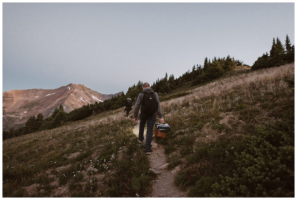 The carried their picnic for after the ceremony up the trail where they would eventually stop to change into their elopement clothes for their private wedding ceremony on Scarp Ridge as the sun rose. Photos of this epic sunrise elopement by Maddie Mae Photography.