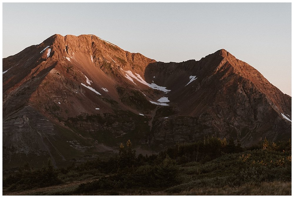With the alpine glow giving way to the bright orange hues of sunrise, they had reached their private elopement ceremony location on Scarp Ridge with only their intimate wedding photographer, Maddie Mae as their witness.