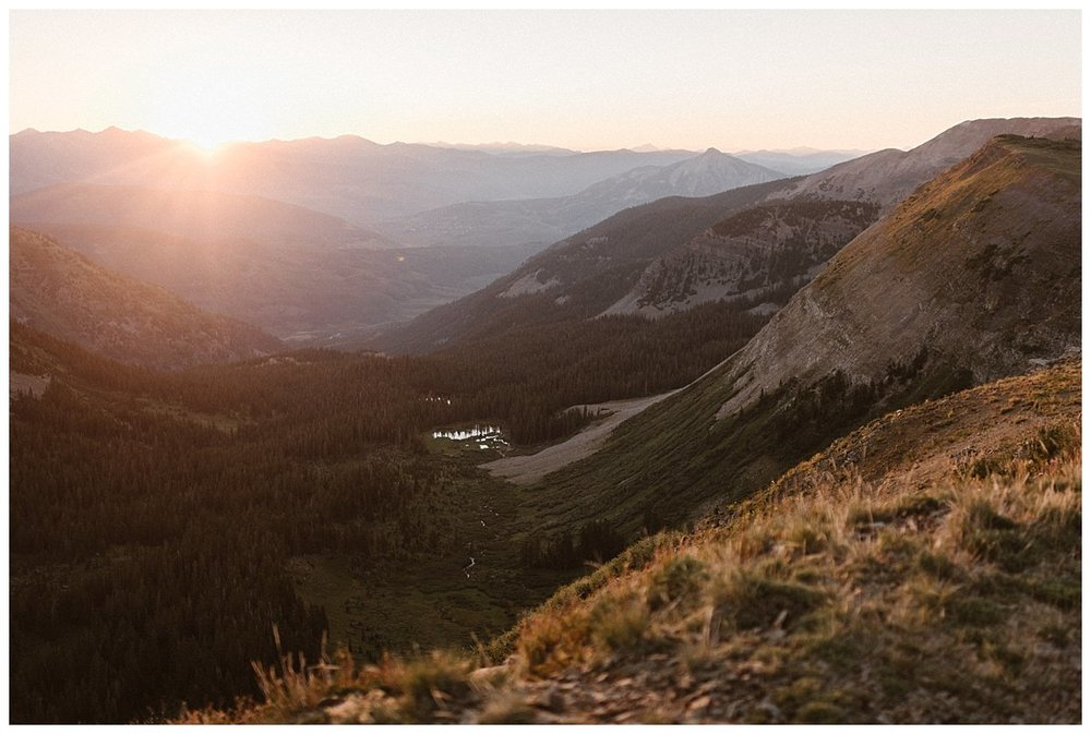 The sun rose over the mountains in Crested Butte giving away to a rainbow of colors of the hillsides where Kourtney and Gabriel picked for their intimate elopement at Scarp Ridge. Photos of their private ceremony by Colorado native photographer Maddie Mae.