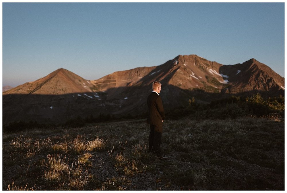 Gabriel waited patiently for his bride in the middle of the meadow with the mountains of Crested Butte shining behind him. He and Kourtney threw out tradition and decided to elope in a private ceremony at Scarp Ridge. Photos by intimate wedding photographer Maddie Mae.