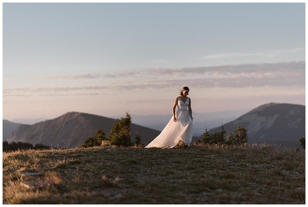 Looking like an angel in the alpine glow, Kourtney was ready to see Gabriel for their first look before their private elopement ceremony at Scarp Ridge near Crested Butte in Colorado. Photos of this sunrise elopement by traveling wedding photographer Maddie Mae.