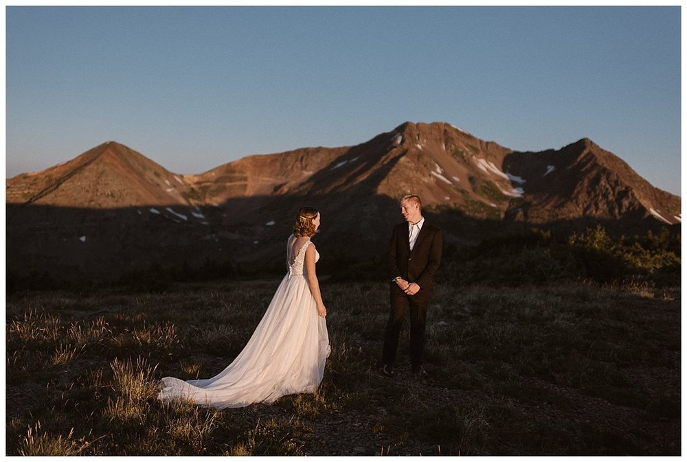 The look on Gabriel's face said it all when he turned around to see his stunning bride donning a flowing white wedding dress - truly a picture of bridal perfection. Photos of this private elopement at Scarp Ridge in Crested Butte by intimate elopement photographer Maddie Mae.