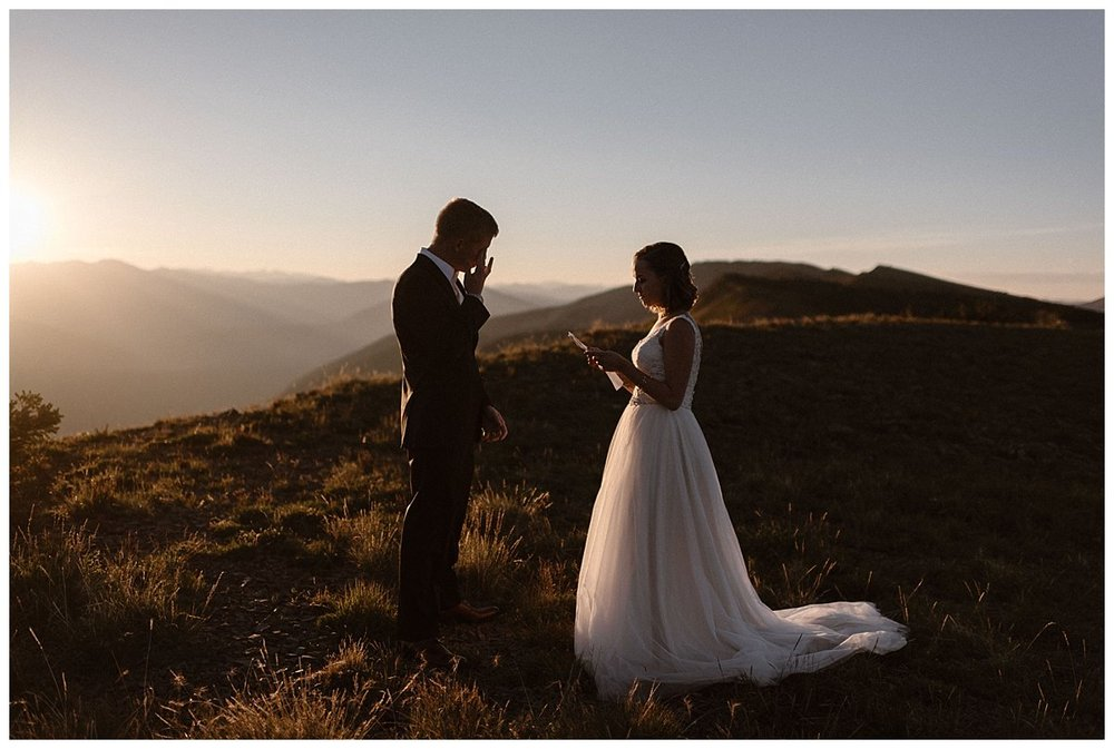 As she finished her intimate vows, her groom wiped the happiest tears from his eyes. Throwing tradition to the wind this adventurous couple hiked in darkness to the top of Scarp Ridge to privately elope with only their intimate wedding photographer Maddie Mae as their witness.