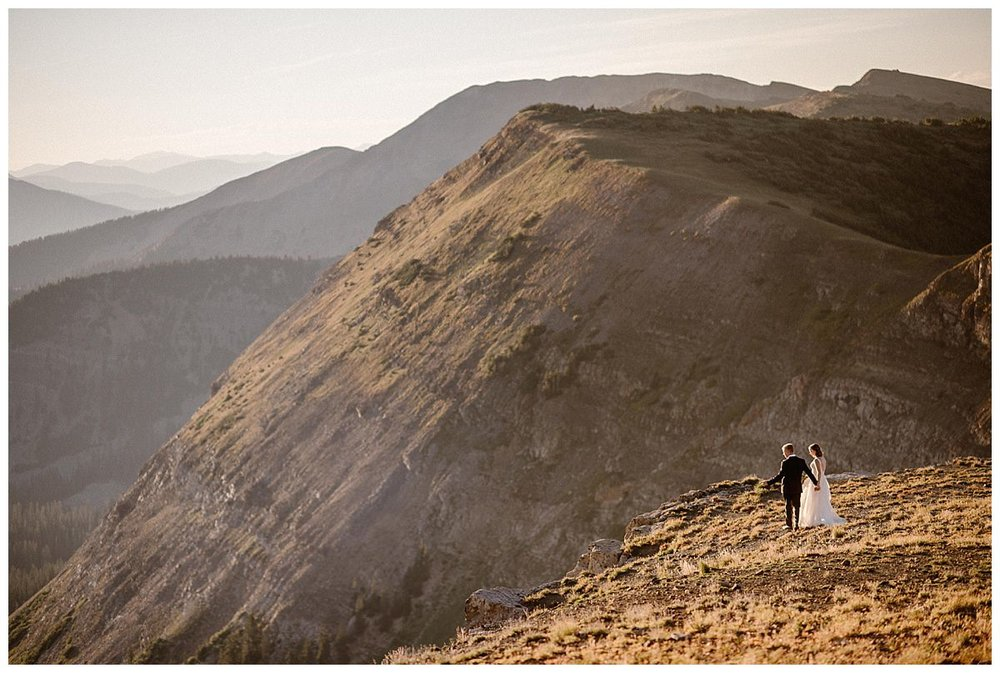With the warm summer sun on their faces, they wandered away from the meadow to the ridge line to see what epic views lay below them now. This intimate elopement at Scarp Ridge near Crested Butte captured by Colorado native, Maddie Mae Photography.