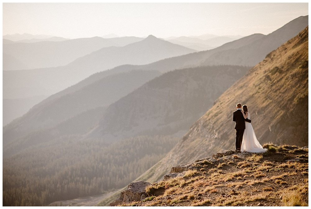 They quietly watched the sun make the rest of its accent high into the sky. Not a soul was around them on that summer morning as they held their private elopement ceremony high in the mountains of Crested Butte at Scarp Ridge. The only witness to their intimate elopement was their traveling wedding photographer Maddie Mae.