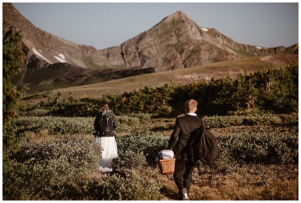 This adventurous couple continued on, making their way along the trail for a post ceremony picnic at Scarp Ridge. Photos of this epic sunrise elopement near Crested Butte, Colorado captured by intimate wedding photographer Maddie Mae.