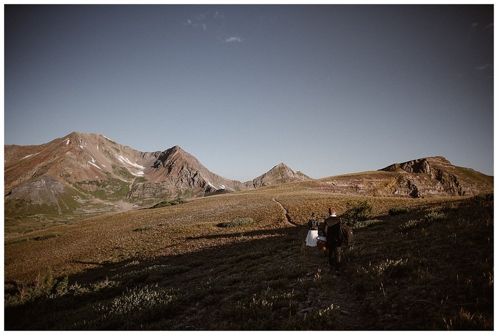 They adventured on up Scarp Ridge flanked by fields of Colorado's summer wild flowers. Photos of this epic hiking elopement near Crested Butte by intimate elopement photographer Maddie Mae.