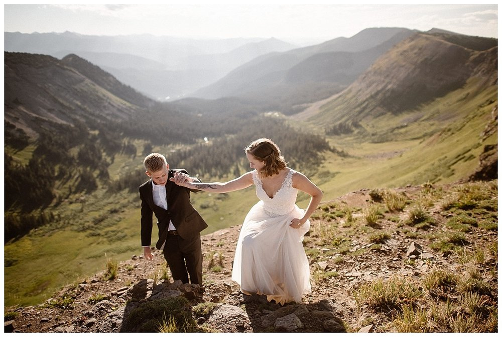 As they helped each other up the rocky ridge side, their love could be felt for miles away. Their intimate Scarp Ridge elopement near Crested Butte captured by adventurous wedding photographer Maddie Mae.