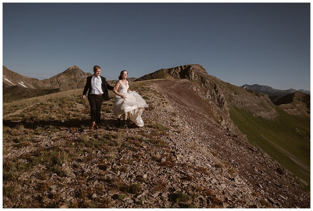 Running down the ridge line is always fun, especially in a flowing white wedding dress with your new husband by your side! These outdoor lovers opted out of a traditional wedding and eloped privately in the Crested Butte mountains at Scarp Ridge. The only witness to their private ceremony was their intimate wedding photographer Maddie Mae.