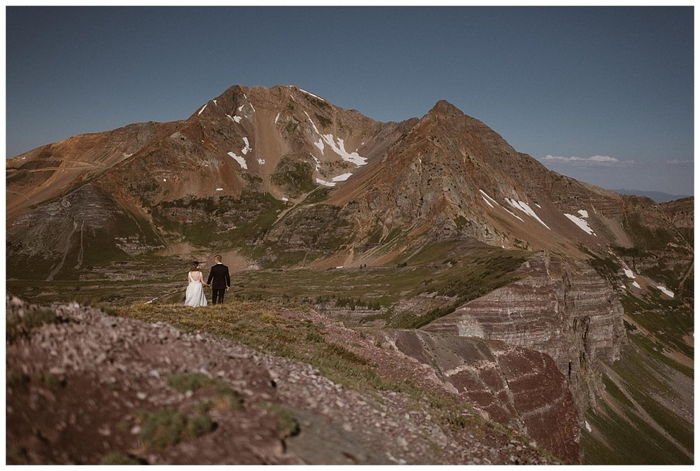 Hand in hand, they wandered down the grassy ridges of the Crested Butte mountains where they celebrated their private adventurous elopement with only their traveling wedding photographer Maddie Mae in tow.