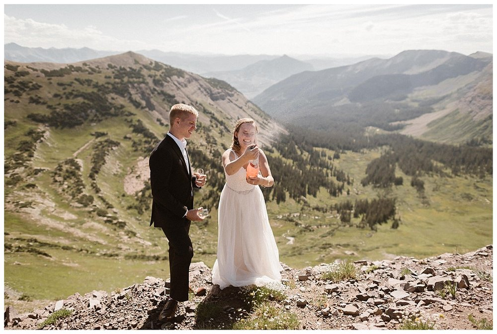 No wedding or elopement is complete without a proper toast. High above Crested Butte Kourtney shook a bottle of rose champagne and popped the bottle in proper fashion. This romantic hiking elopement on Scarp Ridge captured by intimate wedding photographer Maddie Mae.