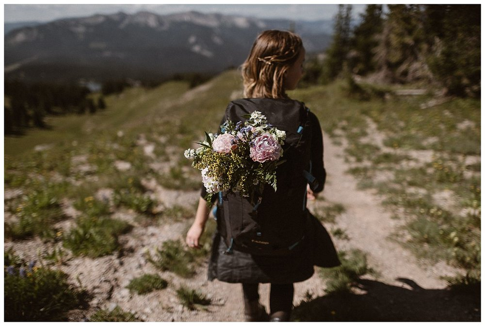 With her oversized summer bridal bouquet in her backpack, Kourtney began the decent back down off Scarp Ridge where she and Gabriel had just celebrated their epic elopement with a hike through the Crested Butte mountains with only their intimate wedding photographer Maddie Mae to capture the day.