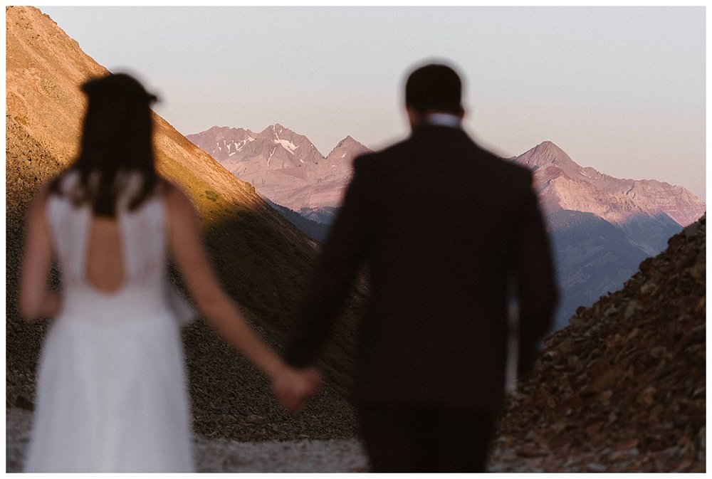 The reached a spot that perfectly over looked the San Juan Mountains as the sun came up so Clint could surprise his bride with an intimate wedding gift. Photos of this intimate first look before their Telluride Ski Resort wedding by traveling elopement photographer Maddie Mae.