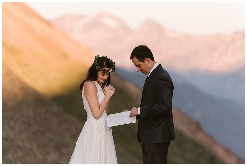 Clint flipped through the pages of the book that Joy had made for him as a wedding gift. The celebrated their nuptials with a private first look up Ophir Pass in the San Juan Mountains before an intimate wedding ceremony at the Telluride Ski Resort. Photos of this romantic wedding by traveling elopement photographer Maddie Mae.