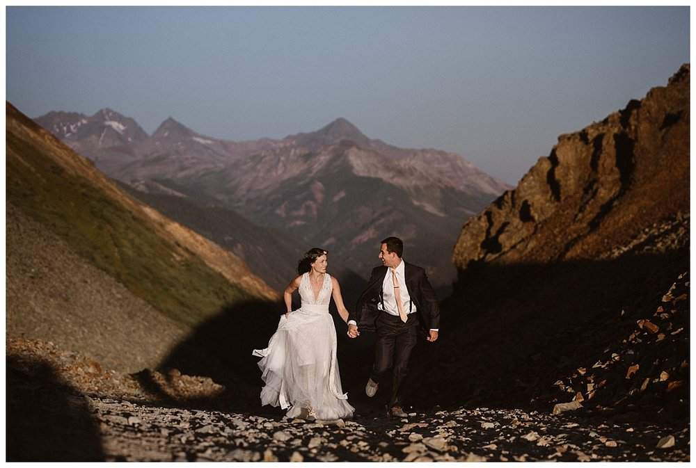 Running onwards into the bright morning sunlight in the San Juan Mountains, Joy and Clint made their way back to their rented Jeep 4x4 so they could continue with their epic adventurous Telluride wedding day with their intimate elopement photographer Maddie Mae in tow.