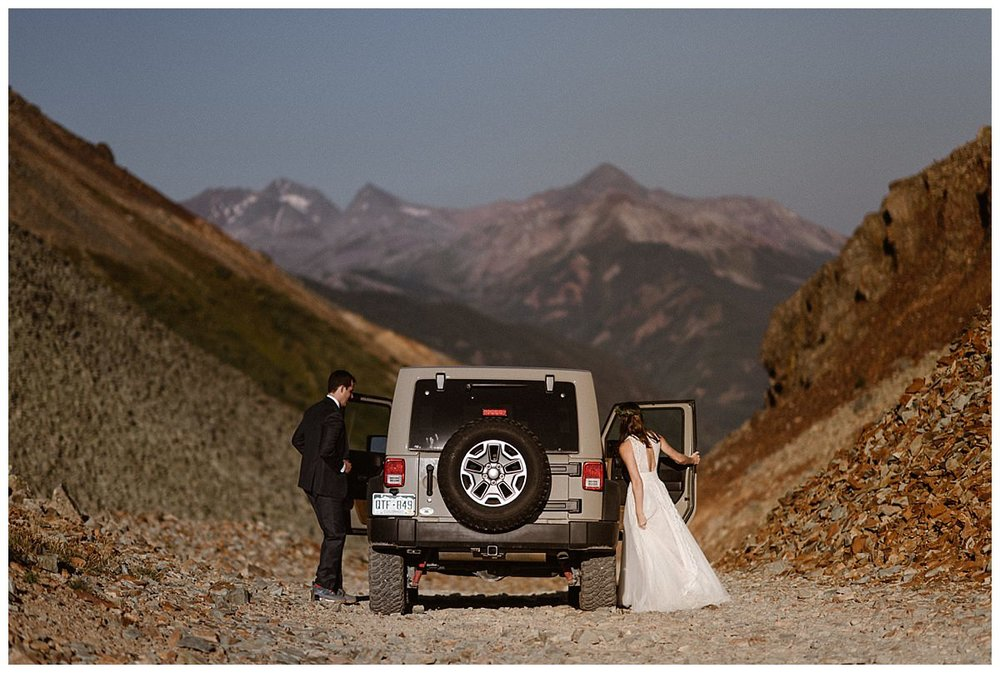 They hopped back in their Jeep 4x4 and continued onwards down Ophir Pass in the San Juan Mountains.  Photos of this epic sunrise first look and intimate wedding at the Telluride Ski Resort by Colorado native and traveling wedding photographer Maddie Mae.