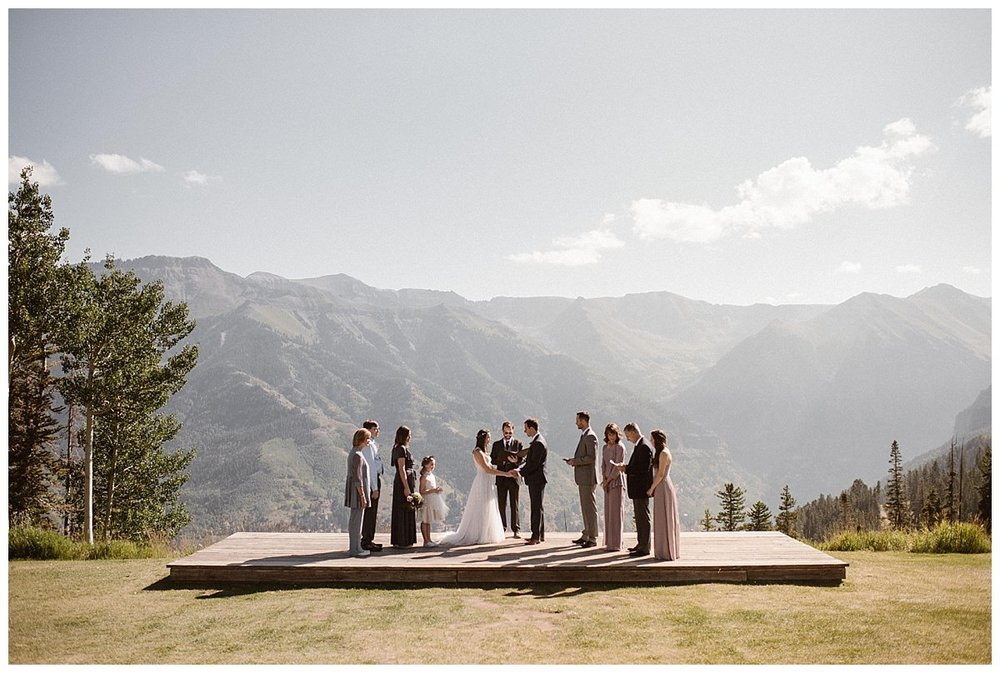 As the early afternoon light settled in, Joy and Clint's intimate wedding ceremony at Telluride Ski Resort began with only their families and closest friends in attendance. Photos of this mountain top wedding by intimate elopement photographer Maddie Mae.
