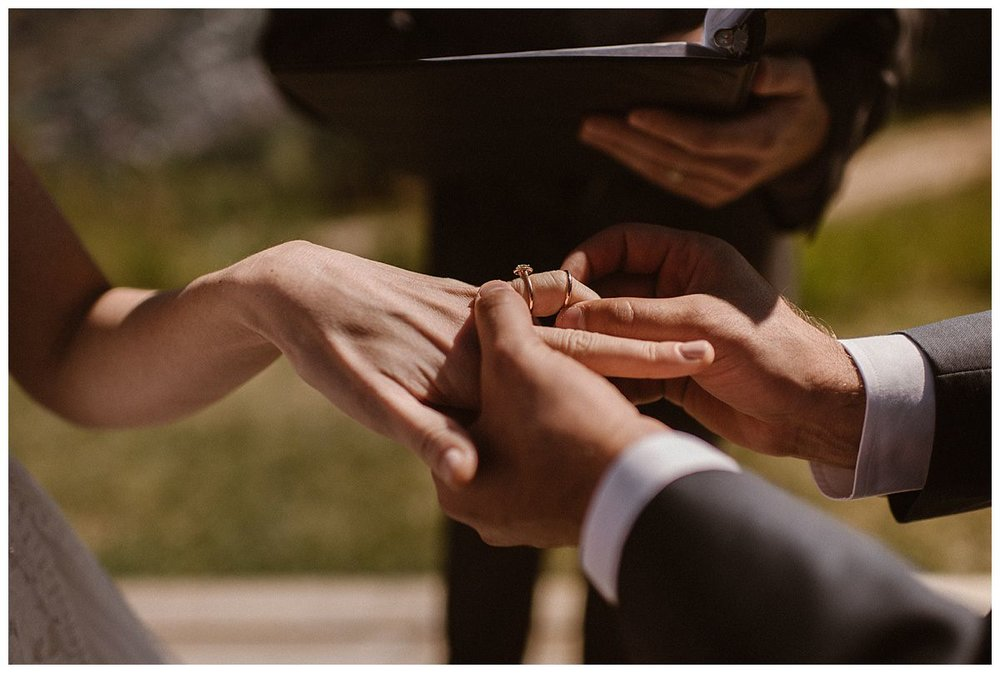 Clint slipped Joy's slender gold wedding band over her knuckle as he proclaimed his affection for her at their intimate wedding ceremony at the Telluride Ski Resort. This romantic and adventurous wedding was captured by traveling elopement photographer and Colorado native, Maddie Mae Photography.
