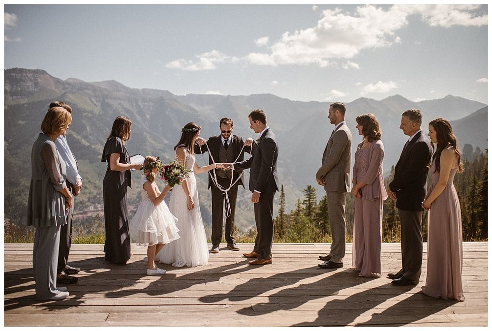 Before they finished their intimate wedding ceremony, they performed a hand-fasting ceremony, a traditional Celtic ceremony performed at weddings. Photos of this romantic Telluride Ski Resort wedding by intimate elopement photographer Maddie Mae.
