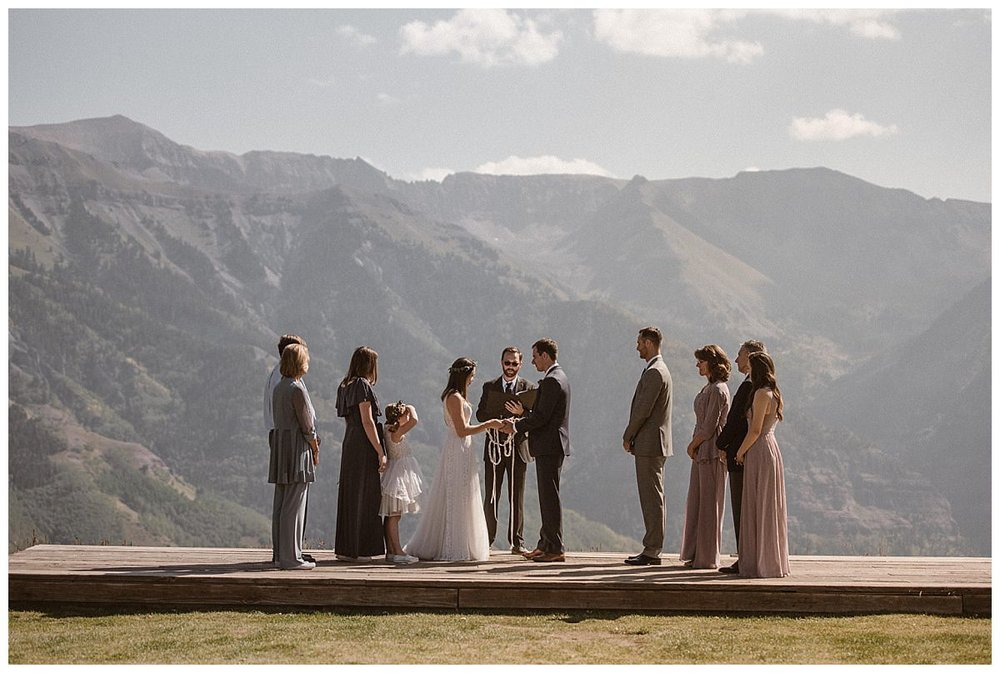 "With their hands literally tied together and their families looking on, Joy and Clint said their final ""I do's"" with the San Juan Mountains as their backdrop at the Telluride Ski Resort. This romantic and non traditional wedding was photographed by intimate elopement photographer Maddie Mae."