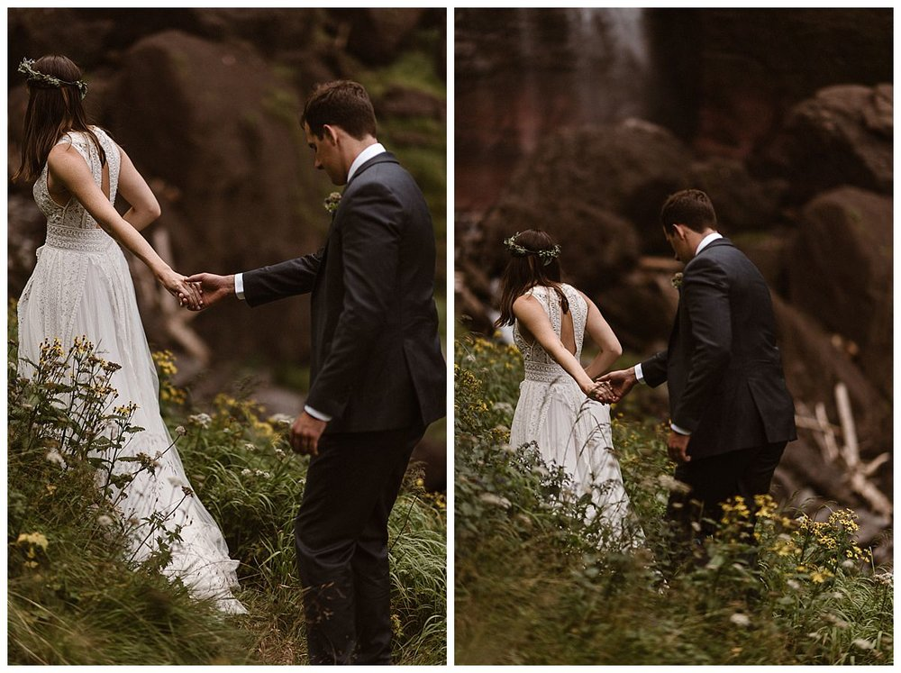 They wandered carefully through the wild flowers at the base of the San Juan Mountains as they hiked their way to Bridal Veil Falls with their intimate wedding photographer Maddie Mae for some private bridal portraits after their emotional wedding ceremony in Telluride.