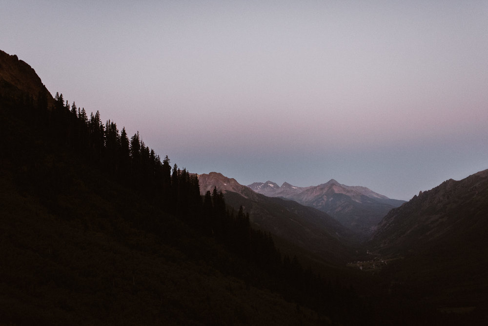 It's just before the sun comes up, when the sky becomes pink that all the magic in the mountains happens. Joy and Clint opted for a private first look in the San Juan Mountains in Telluride for their intimate first look before their wedding ceremony at the Telluride Ski Resort. The only witness to their intimate early morning was their traveling wedding photographer and Colorado native, Maddie Mae.