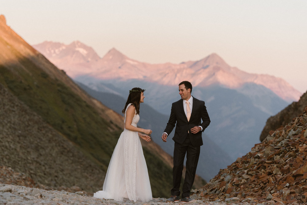 Clint couldn't hide his excitement as he turned around to see his glowing bride for the first time as the sun rose over the San Juan Mountains near Telluride where he and Joy were about to celebrate their intimate wedding with only their closest friends and family and their traveling wedding photographer Maddie Mae.
