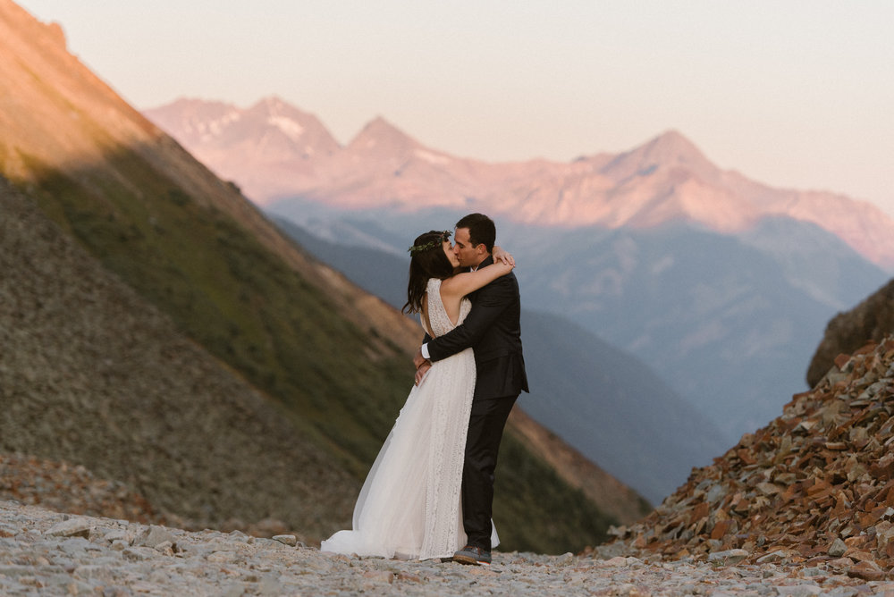Joy and Clint's excitement and affection could be felt for miles as they embraced high in the San Juan Mountains near Telluride where they were celebrating their intimate wedding with a private first look with only their traveling wedding photographer Maddie Mae with them to snap each affectionate moment.