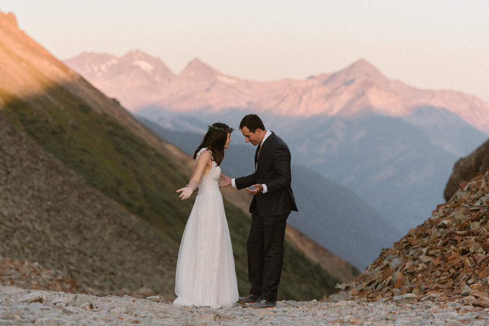 Cline was in awe of his stunning mountain bride, donning a vintage style white wedding dress and a delicate flower crown. Joy and Clint opted for a private first look in the San Juan Mountains with only their intimate wedding photographer Maddie Mae, before their small ceremony at the Telluride Ski Resort with their closest friends and family.