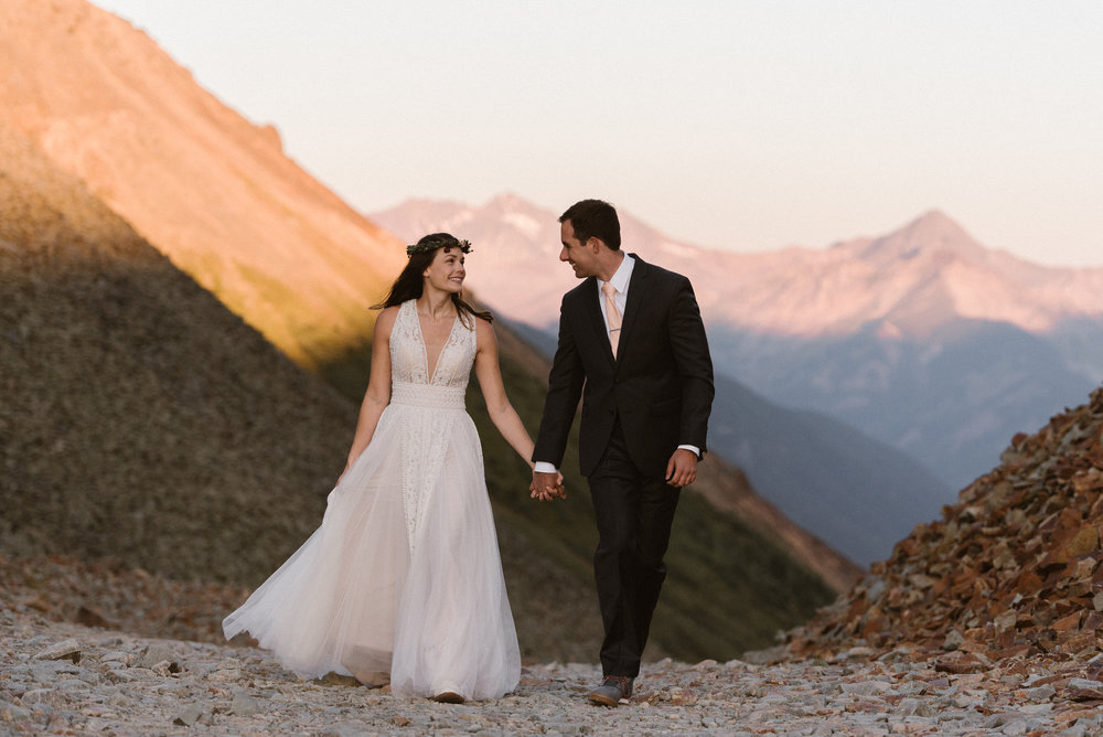 They continued on down the private path they had found for their sunrise first look before their intimate wedding ceremony at Telluride Ski Resort. Opting for adventure with their traveling wedding photographer Maddie Mae, they rented a Jeep 4x4 to find the most secluded location in the San Juan Mountains.