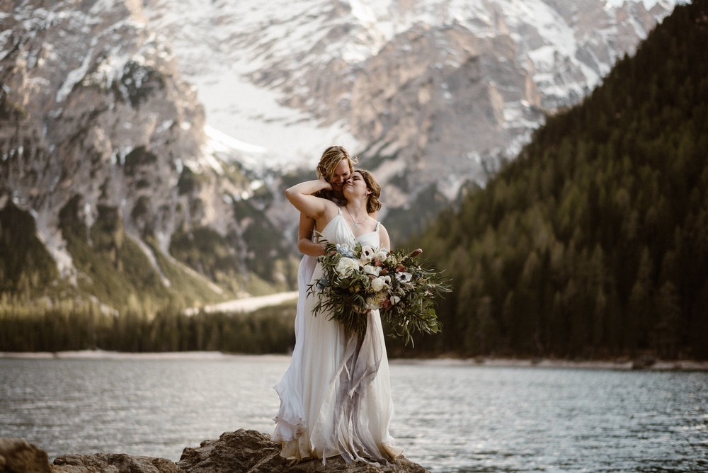lesbian-elopement-lake-como-elopement-gay-elopement-two-brides-intimate-embrace-oversized-bridal-bouquet-italian-elopement-dolomite-elopement-winter-elopement-Maddie-mae-adventure-elopement-photographer-adventure-wedding-photographer-colorado-elopement-photographer00099.JPG