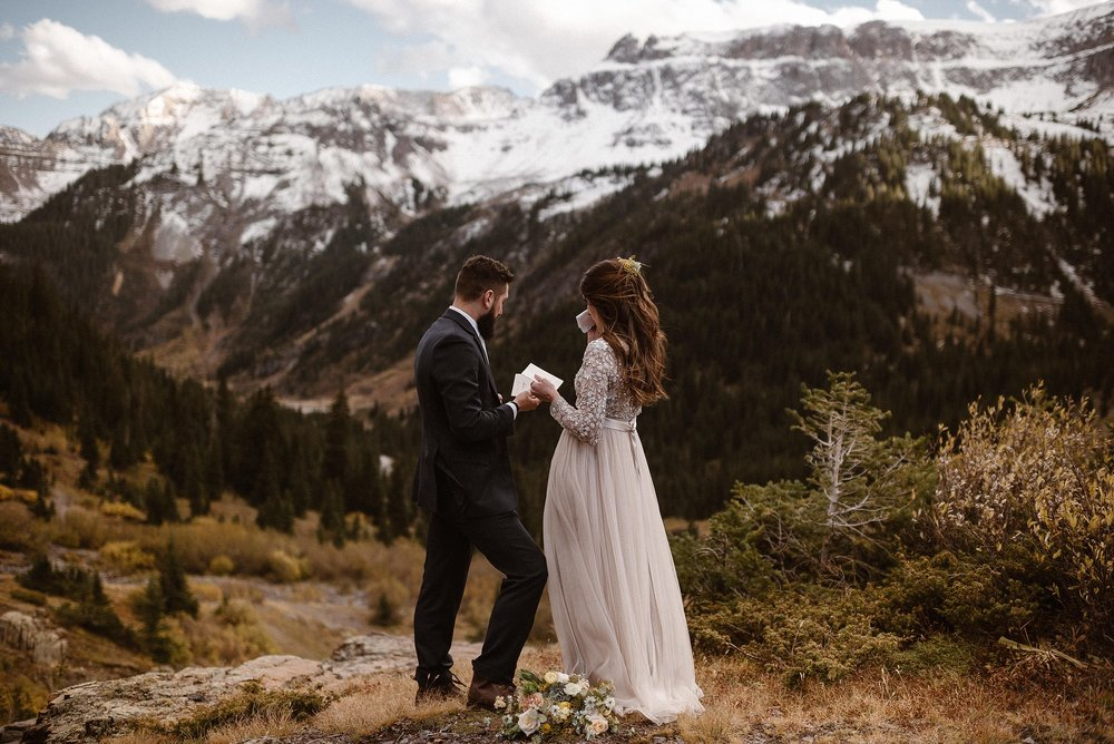 They paused for a moment, wiping away tears of happiness and taking in the epic views around them - soaking in each moment of their adventurous elopement through Yankee Boy Basin in Ouray, Colorado. Photos of this emotional elopement by traveling photographer Maddie Mae.
