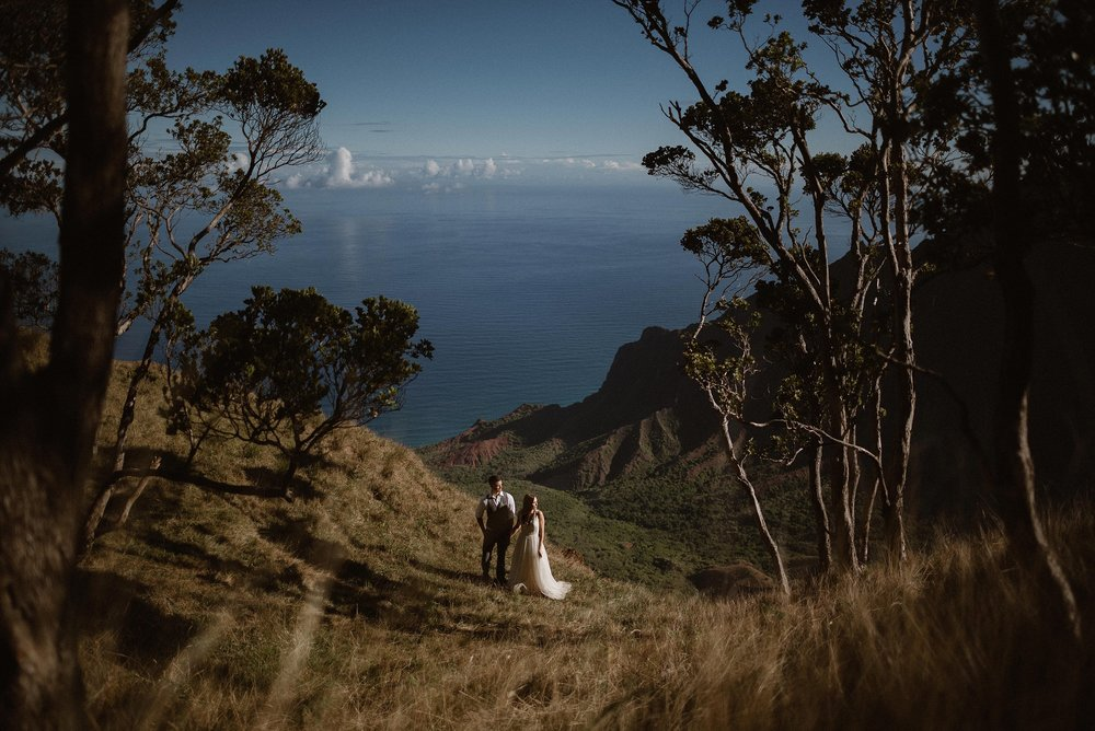 Kourtney and Chris didn't want the traditional wedding in a church and when they decided to elope in Hawaii they wanted to find a different view than just the white sand beaches. With the help of their intimate elopement photographer Maddie Mae, Kourtney and Chris were able to hike around Kauai's Kokee State Park giving them a view of valleys and the green mountains of the Napali Coast.