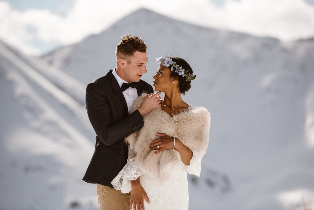 Looking deeply into his wife's eyes, Jared couldn't help but smile at seeing the world of adventure that was ahead of them. This romantic winter elopement up Loveland Pass was captured by traveling wedding photographer and Colorado native, Mattie Mae.