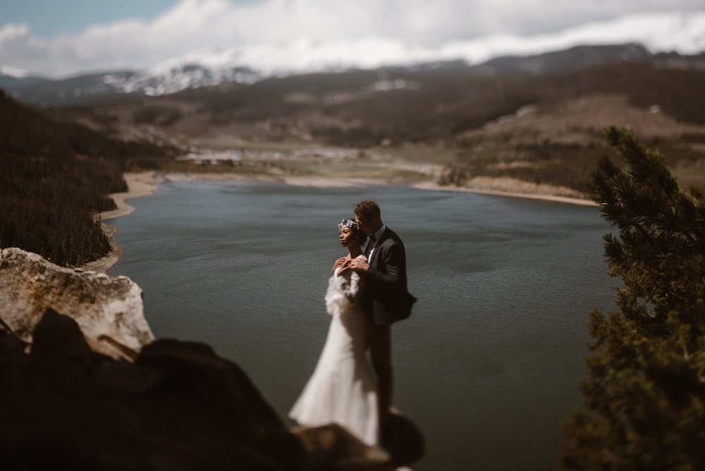With the sun on their faces they stopped to enjoy it's warmth on the hill sides above Dillion Reservoir. They spent the day of their epic elopement adventuring to all their favorite winter spots with their traveling elopement photographer Maddie Mae.