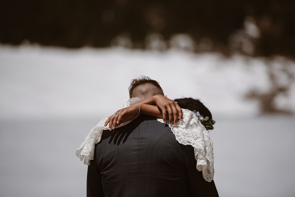 In true Colorado spring fashion, Montgomery Reservoir was frozen over, a stunning sight for these adventurous newly weds. This snowy elopement through the mountains was photographed by intimate wedding photographer, Maddie Mae.