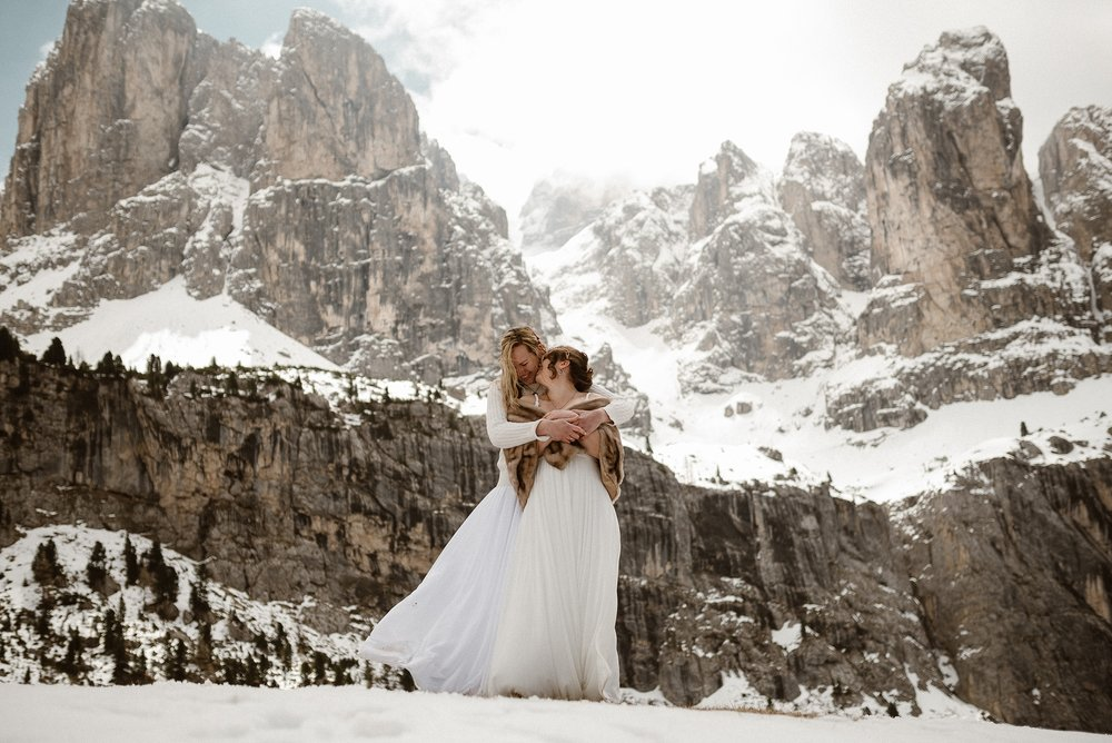 "Their love could be felt through over the hills and well into the Dolomite mountains where these adventurous brides choose to have their intimate elopement ceremony. Inviting only their wedding photographer, Maddie Mae, to be their witness as they said, ""I do."""