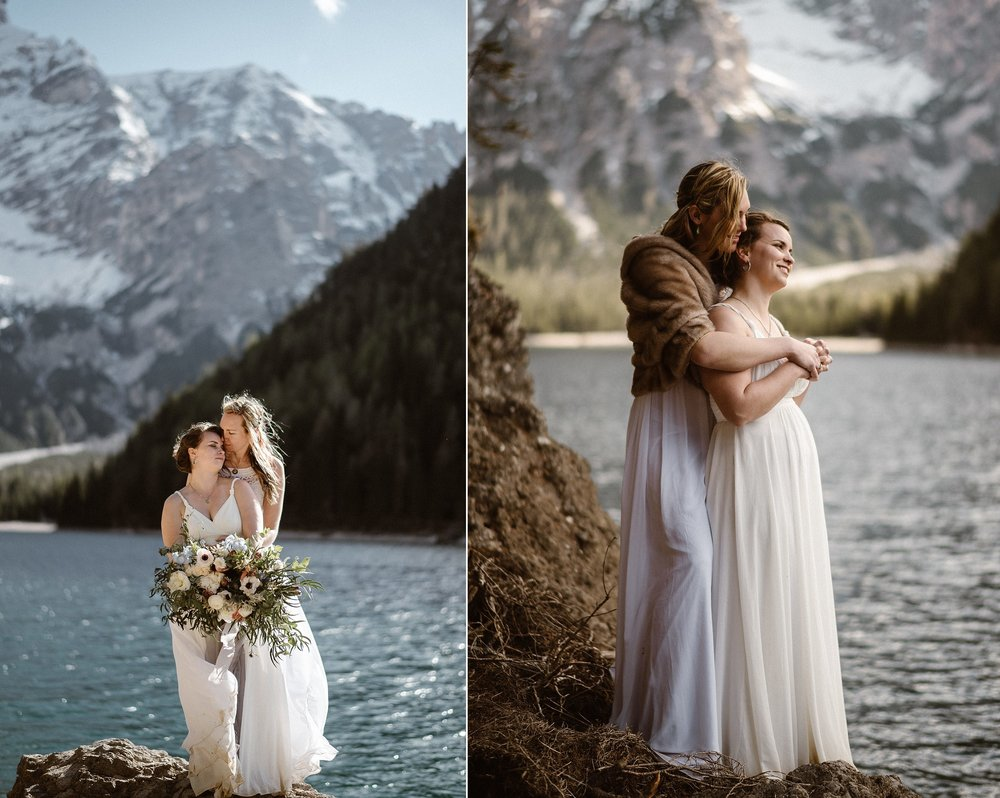 "There are few moments as sweet and honest as the embrace after an intimate elopement. With no one around, these gorgeous brides fell into sheer bliss at Lake Braise in Northern Italy where they had just said, ""I do"" at their intimate elopement. Captured by traveling wedding photographer Maddie Mae."