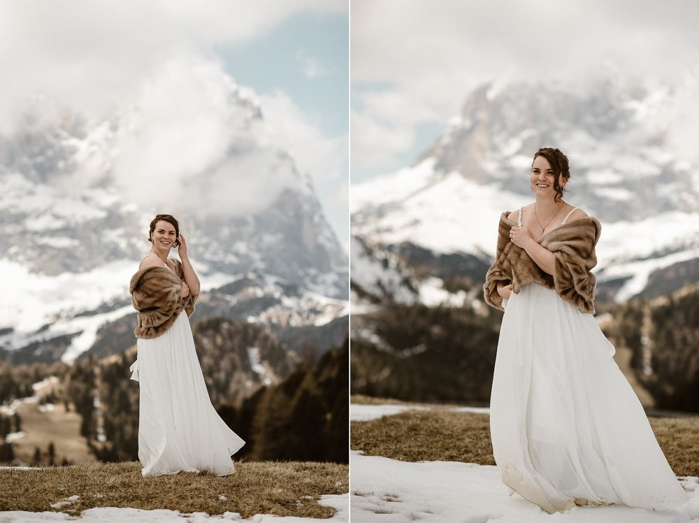 Donning a fur stole and simple but stunning white wedding dress, the love that E felt for R could be felt for miles through the Italian Dolomites where this adventurous couple picked for their intimate elopement. Photos by wedding photographer Maddie Mae.