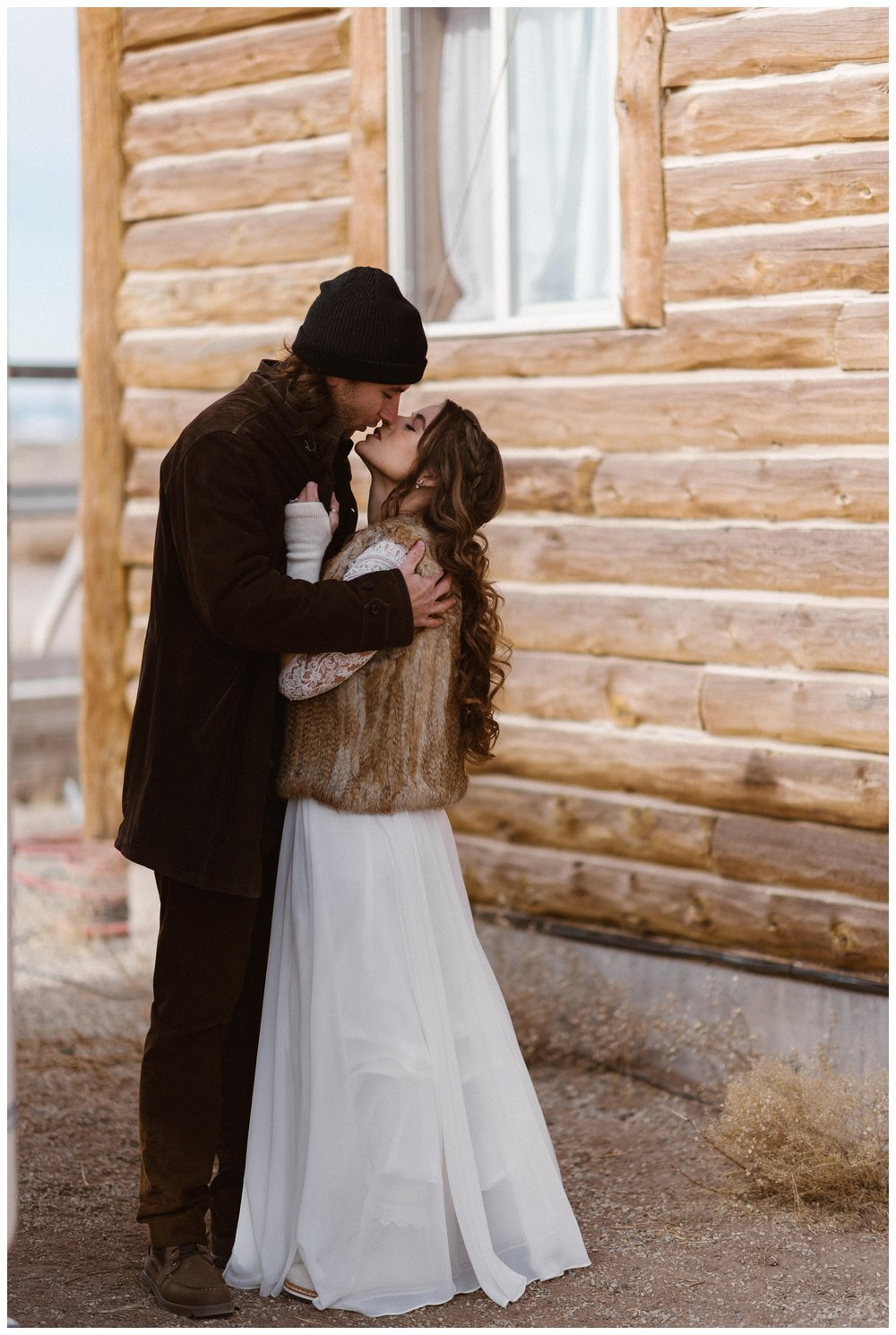 Olivia and Justin outside their cabin near Great Sand Dunes National Park before their winter adventure elopement. Photo by Maddie Mae Photo, Adventures Instead.