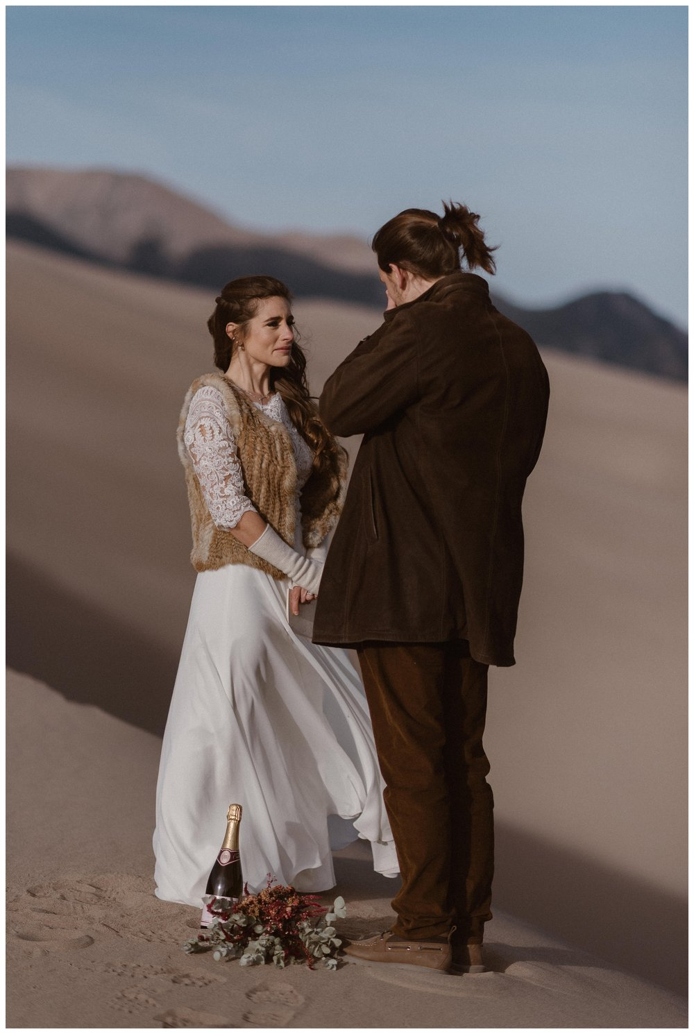 Standing along on top of the dunes at Great Sand Dunes National Park in Southern Colorado for a self solemnizing wedding elopement ceremony. Photo by Maddie Mae Photo, Adventures Instead.