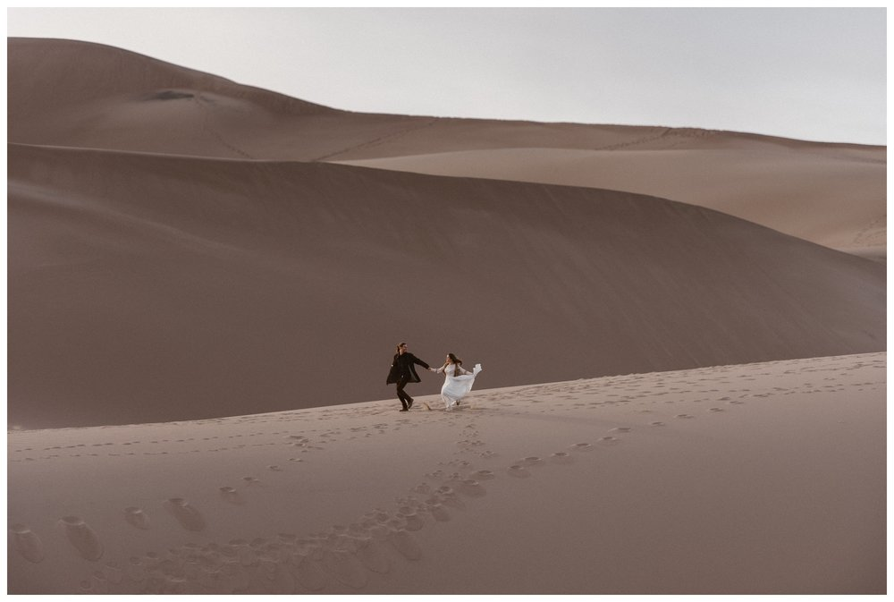 The Great Sand Dunes National Park is a great Colorado elopement venue especially in the winter where you can be totally alone. Photo by Maddie Mae Photo, Adventures Instead.
