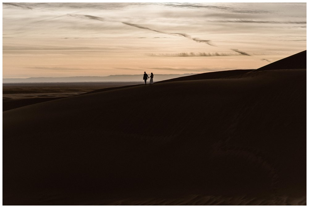 The sun sets at Great Sand Dunes National Park for Olivia and Justin's intimate Great Sand Dunes National Park winter elopement. Photo by Maddie Mae Photo, Adventures Instead.
