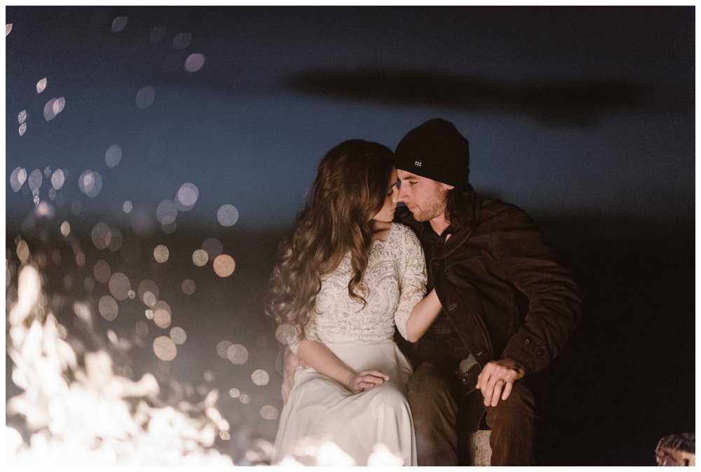 Olivia and Justin keep each other warm after their intimate adventure wedding at Great Sand Dunes National Park. Photo by Maddie Mae Photo, Adventures Instead.