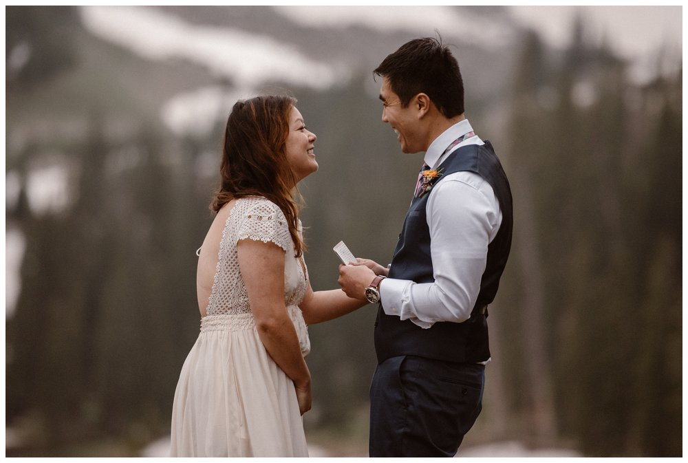 Leslie and Jinson shared heartfelt vows and a few laughs during their hiking elopement ceremony outside Estes Park, Colorado.Photo by Maddie Mae Photo, Adventure Instead.