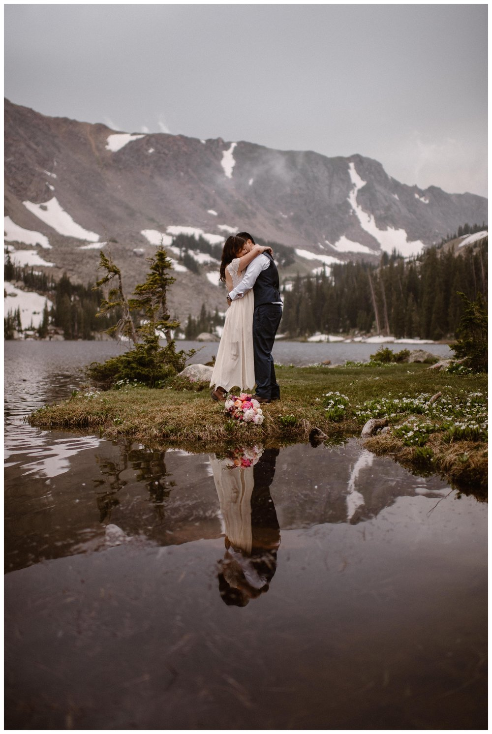 Leslie and Jinson share their first kiss following their self solemnizing elopement ceremony outside Gem Lake near Estes Park, Colorado. Photo by Maddie Mae Photo, Adventure Instead.