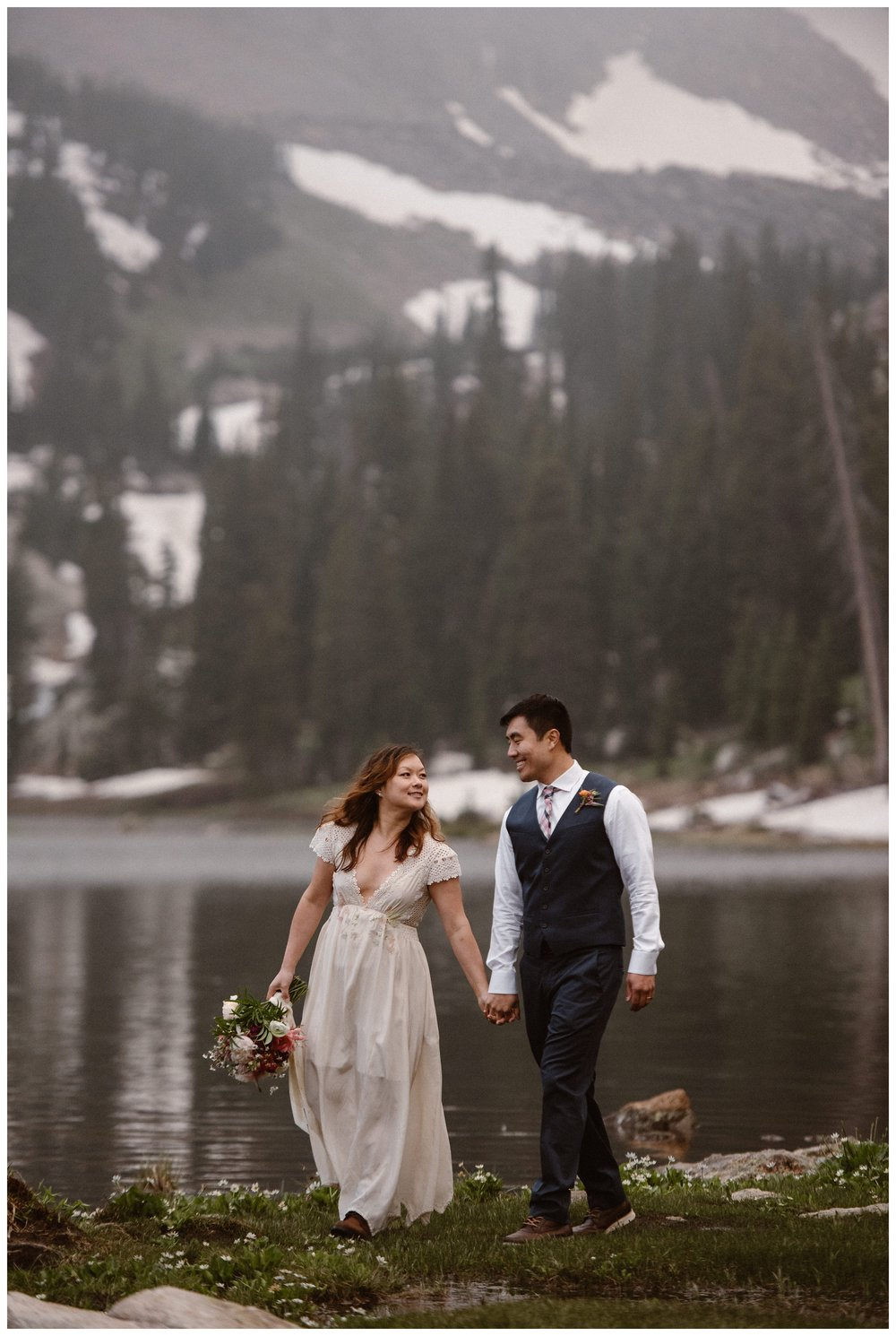 Shortly after their hiking elopement ceremony, Leslie and Jinson walk along the shores of Gem Lake, a high alpine lake outside Estes Park, Colorado. Photo by Maddie Mae Photo, Adventure Instead.