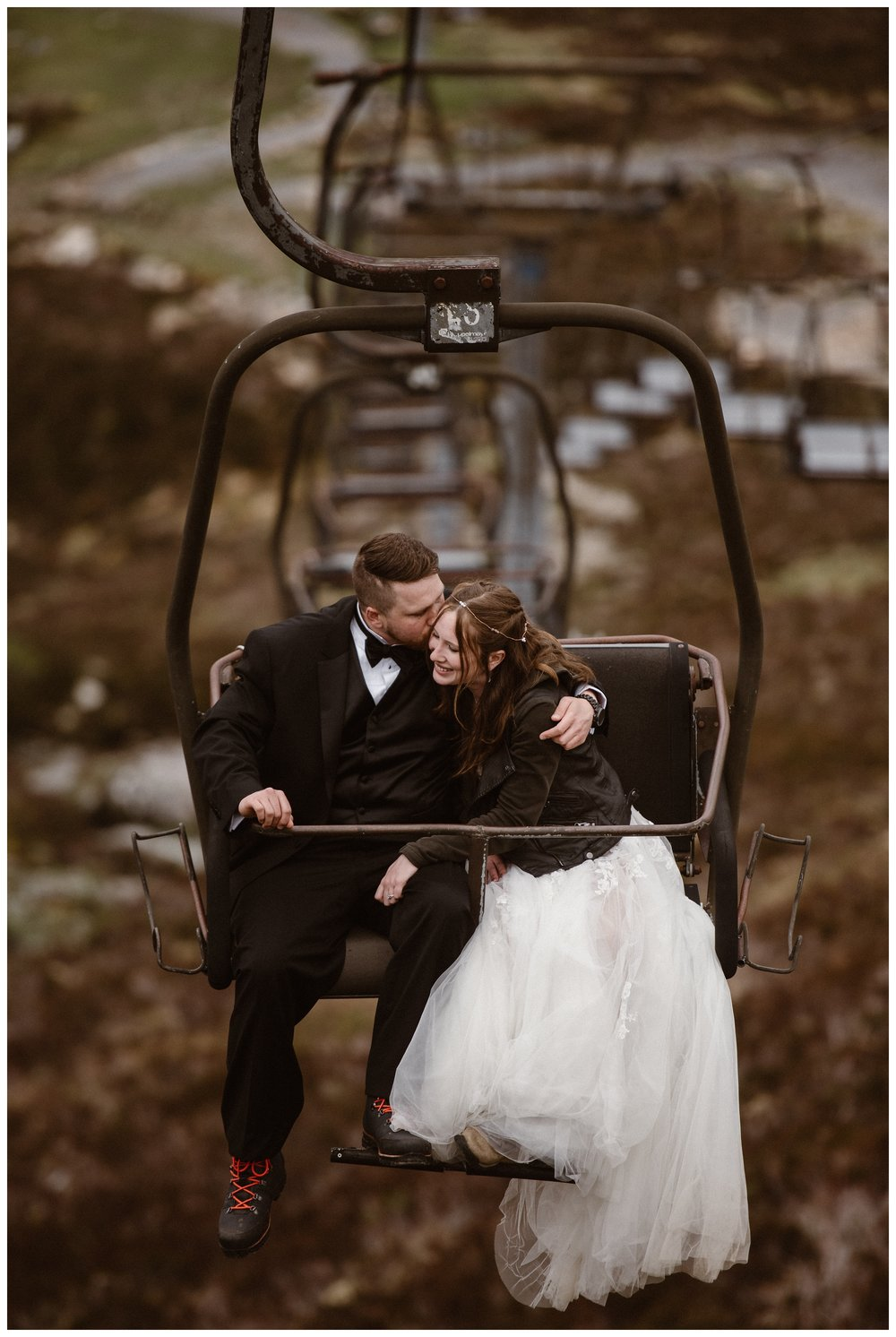 Elissa and Daniel ride a gondola up a mountain dressed in their wedding clothes ahead of exchanging vows during their destination elopement. Photo by Maddie Mae, Adventure Instead.