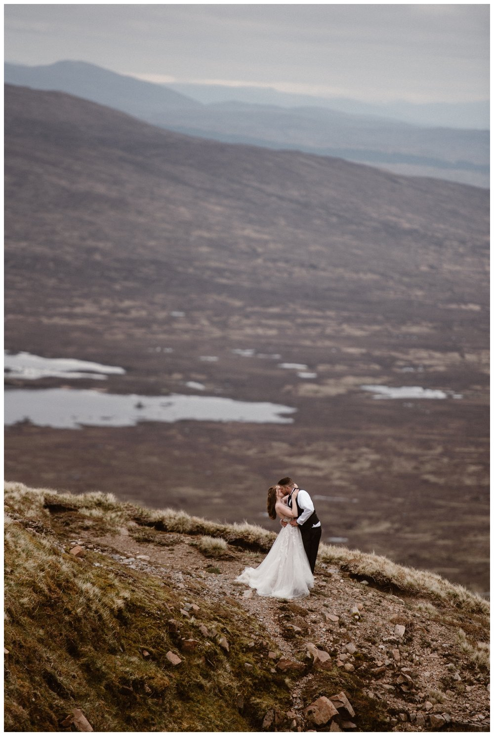 As they explore the bogs and marshes of the Scottish Highlands outside Glencoe, Scotland, Elissa and Daniel share a kiss before their destination elopement. Photo by Maddie Mae, Adventure Instead.