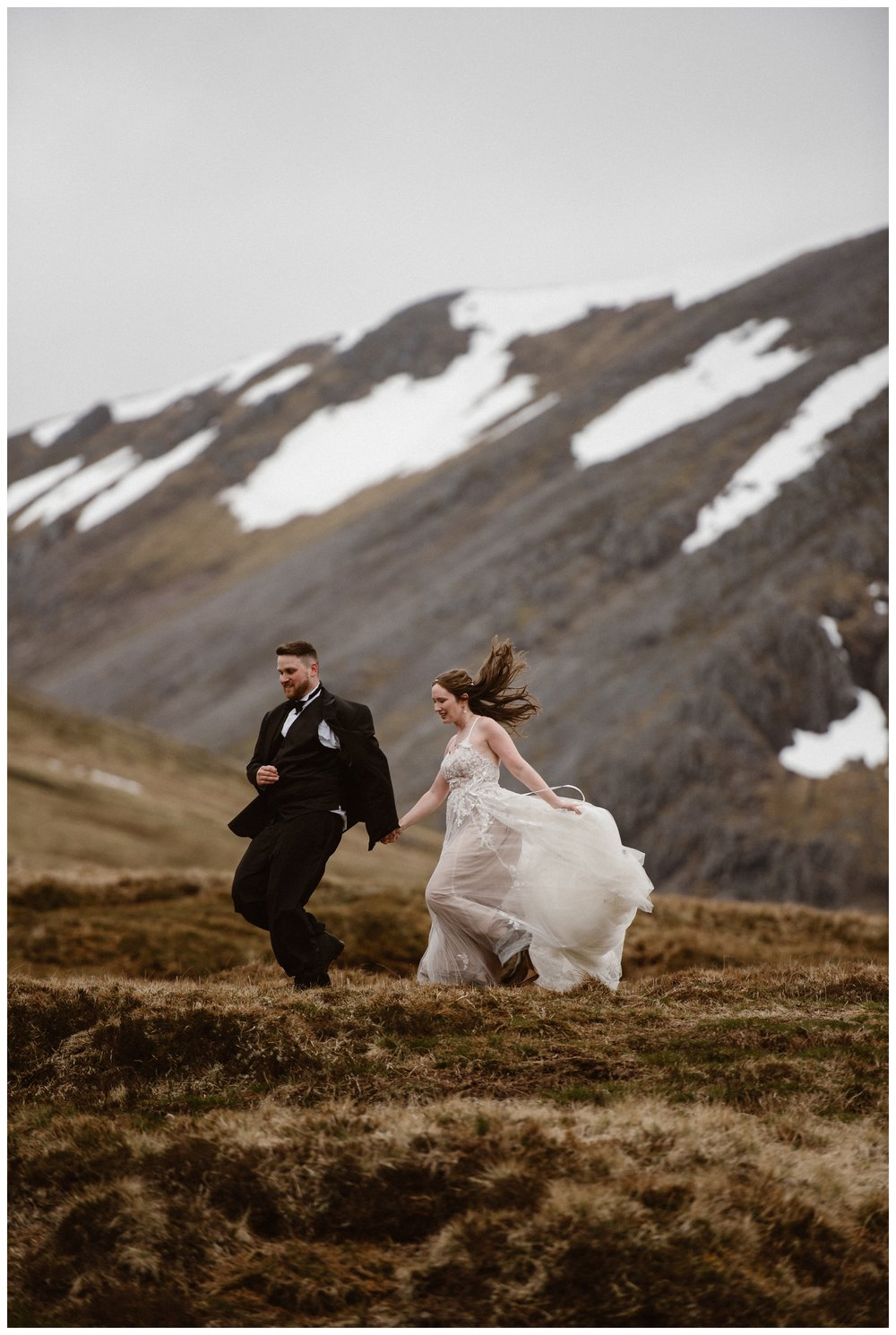 The wind of the Scottish Highlands blows Elissa's wedding dress as she and Dnaiel explore the marshes together before their destination wedding elopement. Photo by Maddie Mae, Adventure Instead.